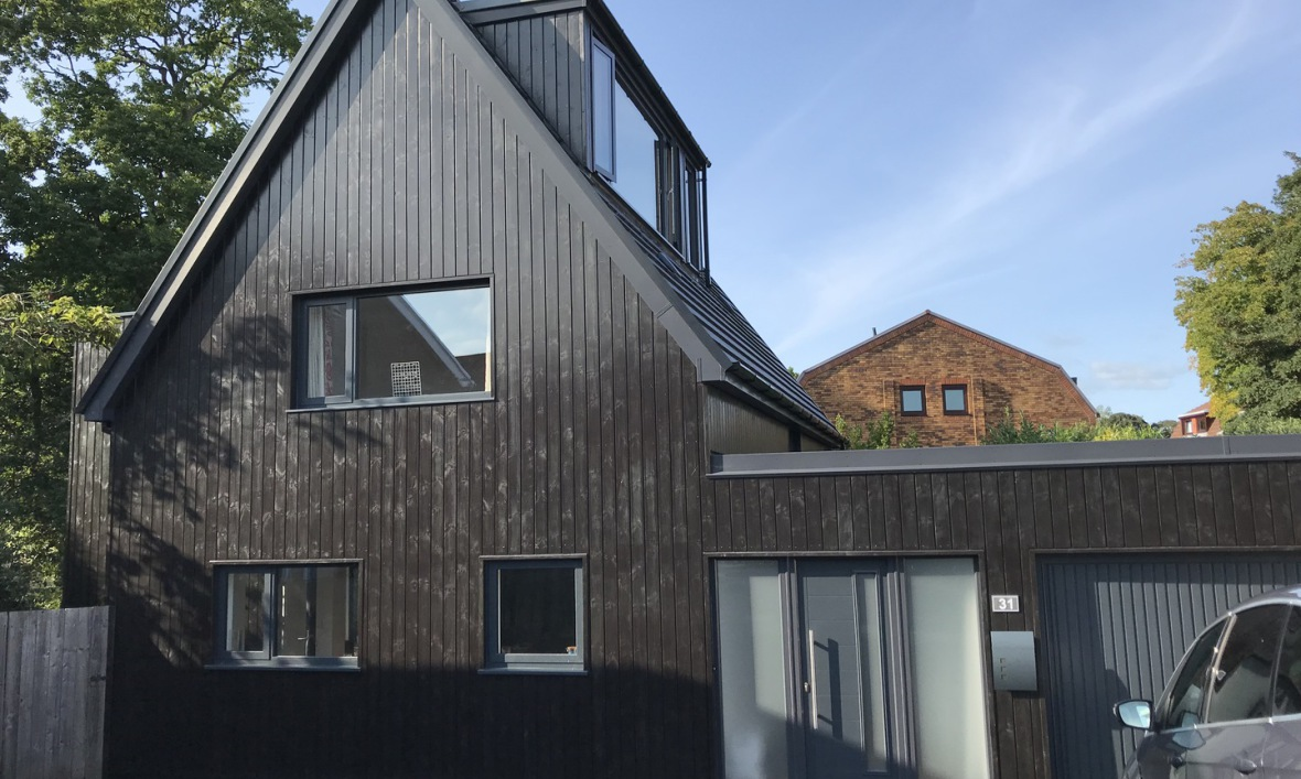 Image of Dramatic and dark newly timber clad house