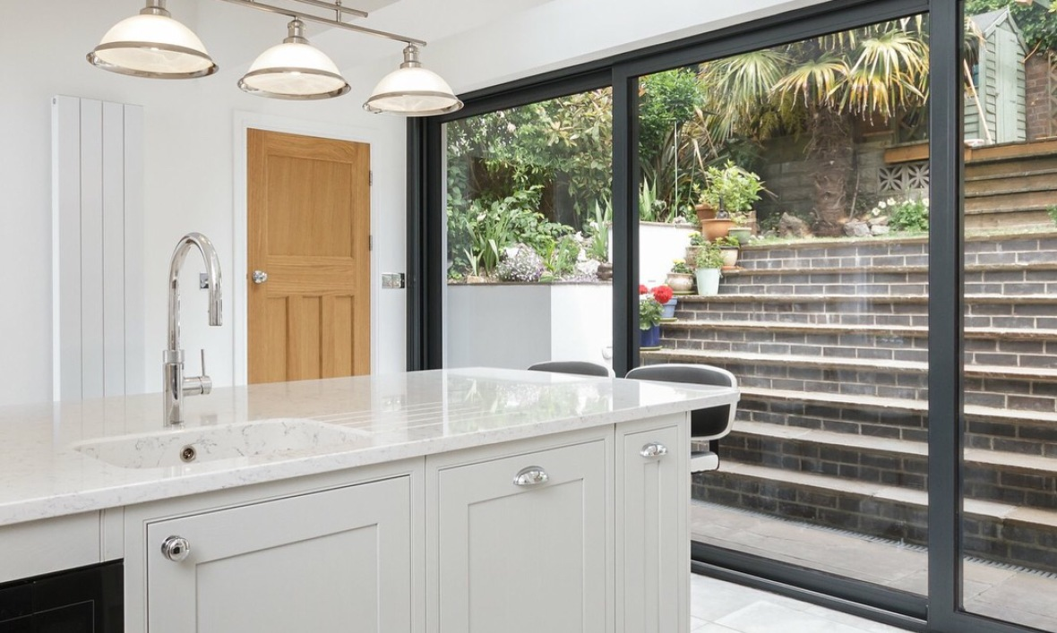 image of kitchen and steps outside